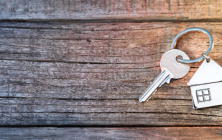Key with house-shaped keychain